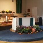 altar decorated with fall flowers